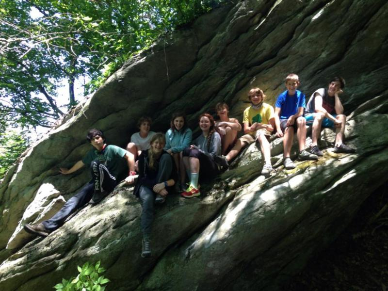 Regular Camp B campers on top of a boulder at Grandmother in Boone, NC
