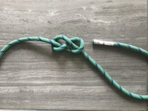 well-dressed figure eight knot pushing standing end aside