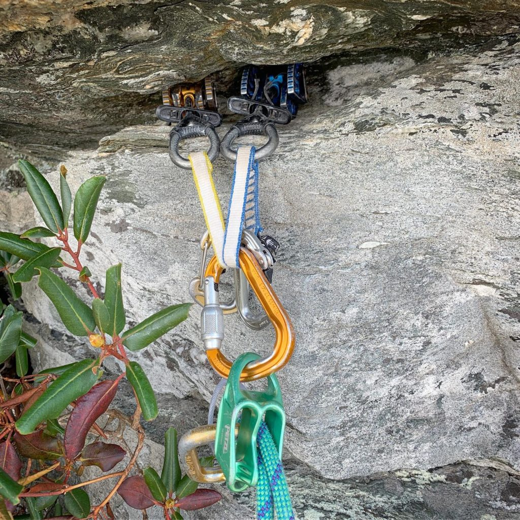 A climbing anchor made of two large cams